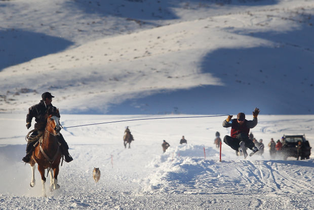horsemen and competitive skiers team up for skijoring races