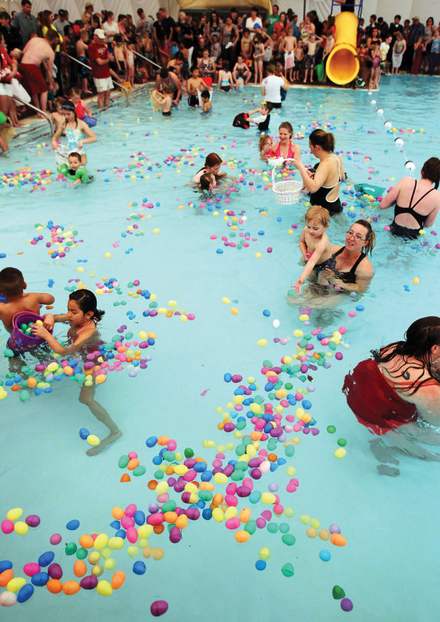 ymca easter egg dive draws hundreds to city pool