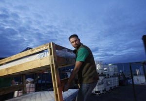 Gallery: Beds Delivered to Children Who Lost Mother