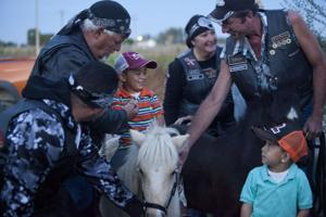 Gallery: Motorcycle Club Delivers Horses to Rupert Family