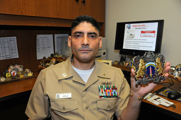 Navy lieutenant packs up military coin collection | News ...