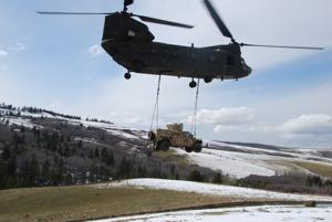 Montana Army National Guard helicopter rescues Air Force Humvee stuck on muddy road