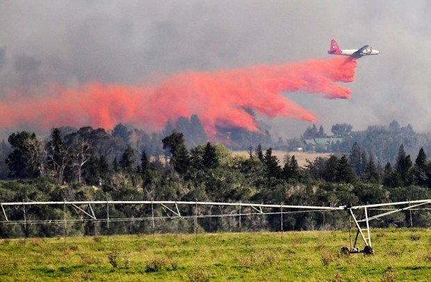 An air tanker drops retardant
