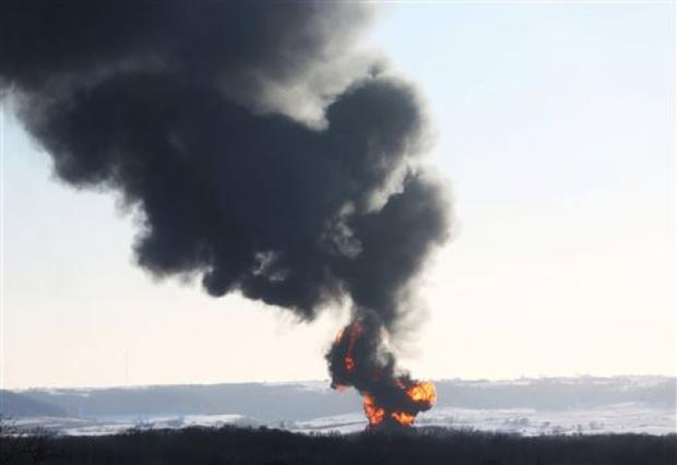 Smoke and flames erupt from the scene of a train derailment Thursday, March 5, 2015, near Galena, Ill. A BNSF Railway freight train loaded with crude oil derailed around 1:20 p.m. in a rural area where the Galena River meets the Mississippi, said Jo Daviess County Sheriff's Sgt. Mike Moser. (AP Photo/Telegraph Herald, Jessica Reilly)