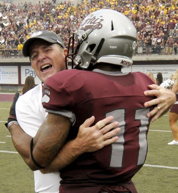 Montana head coach Bob Stitt hugs cornerback Nate Harris after the game. The victory over North Dakota State was Stitt's first game as head coach for the Grizzlies. (Tom Bauer/The Missoulian)