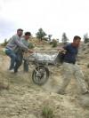 Glenn Storrs, left, helps haul a dinosaur fossil