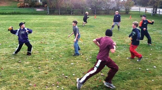 kids playing backyard football backyard bowl youth sports missoulian