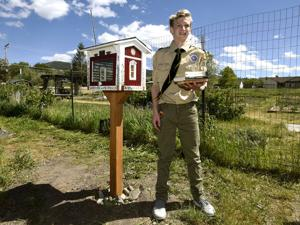 Boy Scout builds little libraries for community gardens