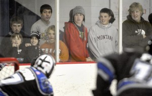 Kids line the boards recently at a Missoula Maulers hockey game.