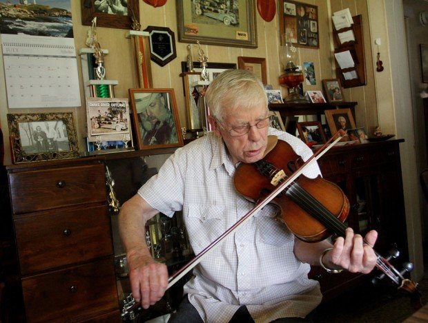 "Jimmy Widner, 87, performs at the Hardtimes Bluegrass Festival Saturday. ""He's the only living legend that I know,"" says festival organizer Mike Conroy."