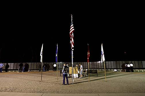Standing Guard: Veterans, law enforcement honor Moving Wall with security
