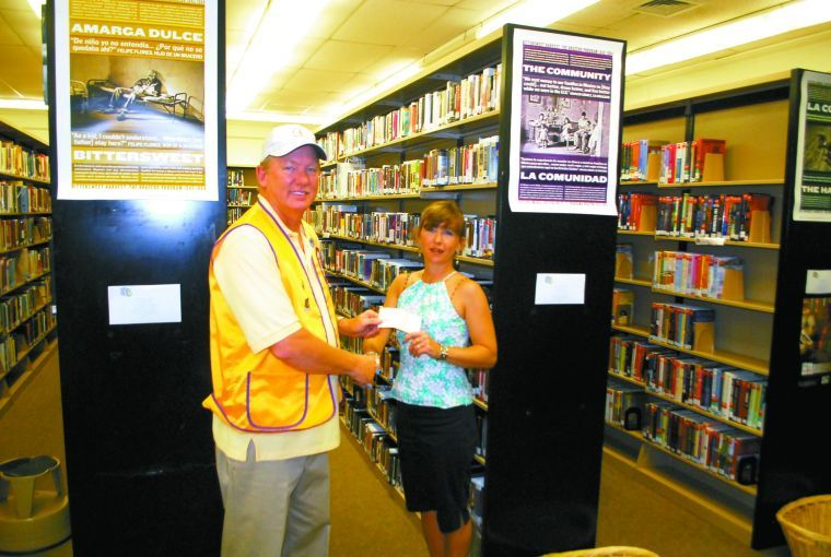 Lions Club donates to library...