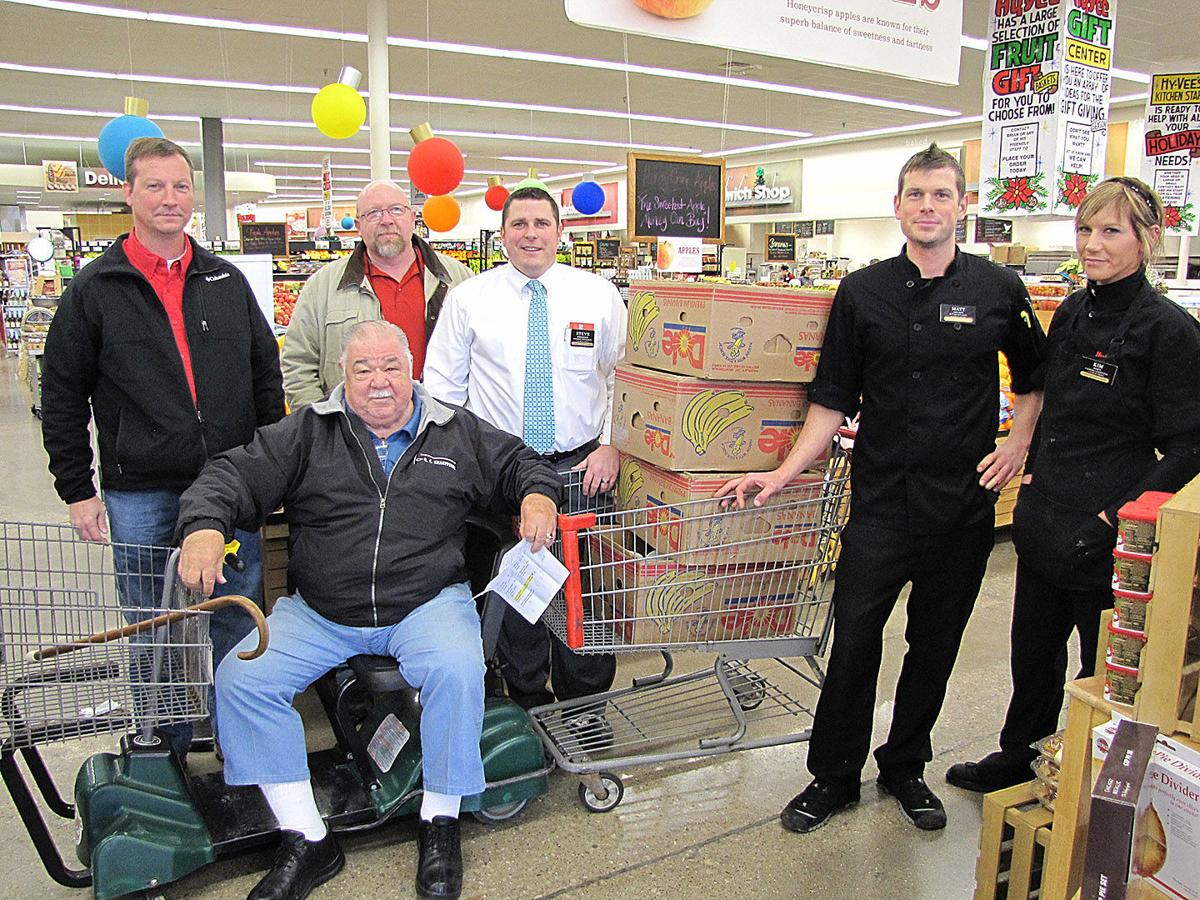 Jim Wiggins (seated) and his HyVee Partners