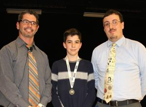 <p>Geo Bee champ crowned</p><p>Stevensville Middle School Geography Bee champion Jack Pearse, center, wears his medal. With him are sixth-grade history teacher Sean Barnum, left, and eighth-grade history teacher Thomas Crise, organizers of the 2016 Stevensville Middle School Social Studies Expo and Geography Bee. See related story, page 21.</p>