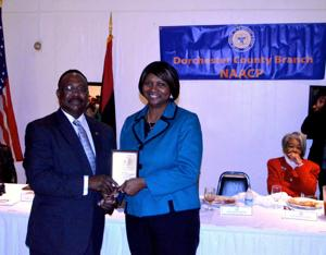 <p>Dorchester NAACP Branch President James Pinkett presents Cambridge Mayor Victoria Jackson-Stanley with a community service award at the branch's Freedom Fund banquet Saturday, Nov. 21.</p>