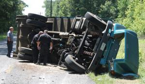 Garbage truck roll over
