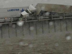 Truck overturns on bridge