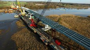 <p>Construction crews continue work as they build a new Dover Bridge on state Route 331 over the Choptank River.</p>