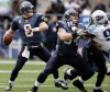 Seattle Seahawks quarterback Matt Hasselbeck, left, drops back to pass as teammate Mike Gibson, center, blocks Tennessee's Sen'Derrick Marks in the second quarter during an NFL game Jan. 3 in Seattle. Gibson went to Napa High and also played football at Solano Community College and Cal.  AP