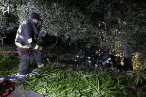 Two women extricated from ravine after police pursuit, crash