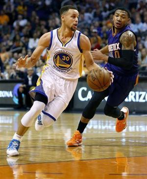 Curry flirts with triple-double, Warriors top Suns 112-104