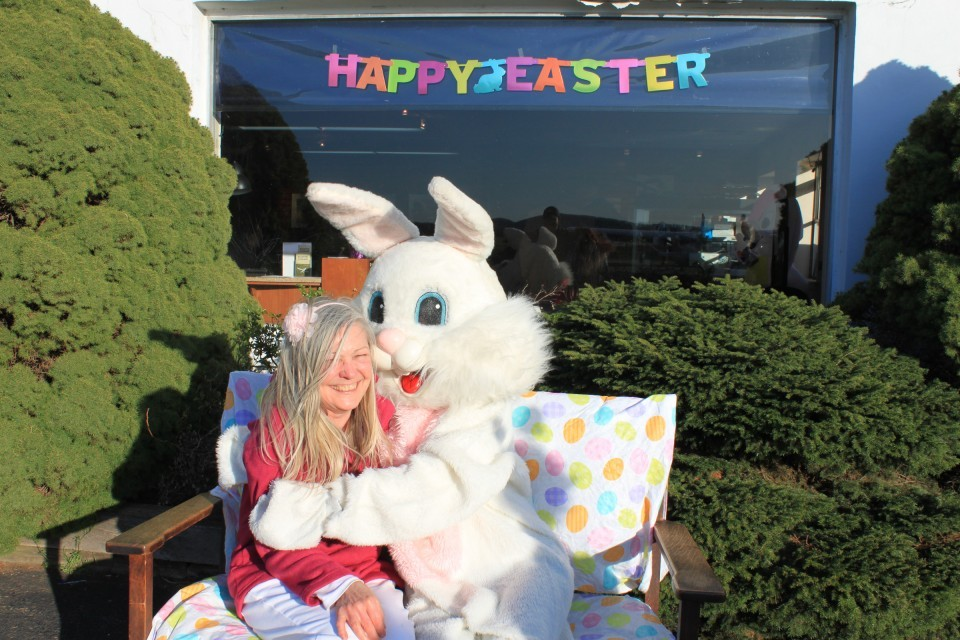 Event organizer Lorraine Solberg grabs a hug from the Easter Bunny after a successful day