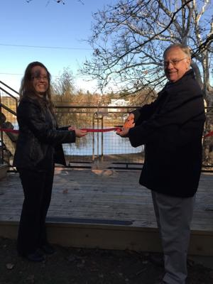 <p>Red Mill Museum Village Executive Director Eileen Morales and Vice President of the Board of Trustees Richard Miller reopen the Mulligan Quarry Screen House.</p>