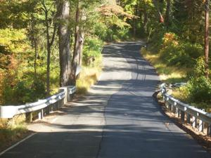 Boundary road repaved on only one town's side