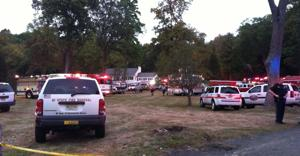 <p>Emergency personnel surround the home in Boonton Township where two workers were trapped in a trench on Wednesday, Oct. 1.</p>