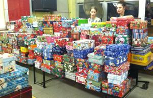 <p>The Rockaway Area Girl Scouts collected about 240 Operation Christmas Child shoe boxes at Thomas Jefferson Middle School in Rockaway Borough on Thursday, Nov. 13. Girl Scout Madison Vandermark, 12, of Rockaway Township, at left andOperation Christmas Child volunteer Kurry Luski work on the final count.</p>