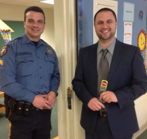 Officer Thomas Sciaretta of Long Hill Township Police and JP Crescenzo, principal of St. Vincent de Paul School