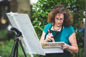 <p>West Caldwell's Marilyn Rose painting on location at at Cross Estate Gardens in Bernardsville.</p>