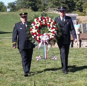 Firefighters lay 9/11 wreath