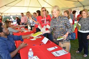 """<p>Ishmael Beah, author of the new novel, """"Radiance of Tomorrow,"""" signs books for attendees at the Morristown Festival of Books Saturday, Sept. 27.</p>"""