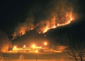 Forest fires burn across Pike