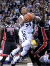 <p>Utah State's Chris Smith drives toward the hoop as UNLV's Goodluck Okonoboh defends during an NCAA college basketball game, Tuesday, Feb. 24, 2015, in Logan, Utah. (AP Photo/Herald Journal, John Zsiray)</p>