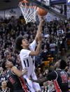 <p>Utah State's Jalen Moore puts up a layup over UNLV's Christian Wood (5) and Dwayne Morgan during an NCAA college basketball game earlier this season.</p>