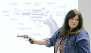 <p>Beverly Powell teaches a class about handguns, Wednesday at the Cache Valley Public Shooting Range.</p>