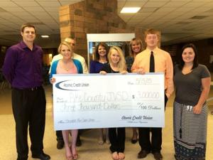Atomic Credit Union awards Pike CTC $3,000