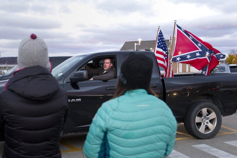 Suspended officer who displayed Confederate flag resigns
