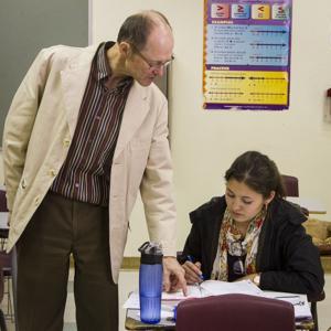 """<p class=""""p1"""">Vladimir Vladimirov helps trigonometry student Santa Arias with her homework.</p>"""