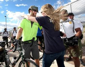 "<p class=""p1"">Erik ""Trek"" Utrecht greets his girlfriend Allison Platt at the Brian A. Terry Border Patrol Station in Naco on Oct. 9. Utrecht finished a 2,050 mile bike ride to raise money for the Brian Terry Foundation. </p>"