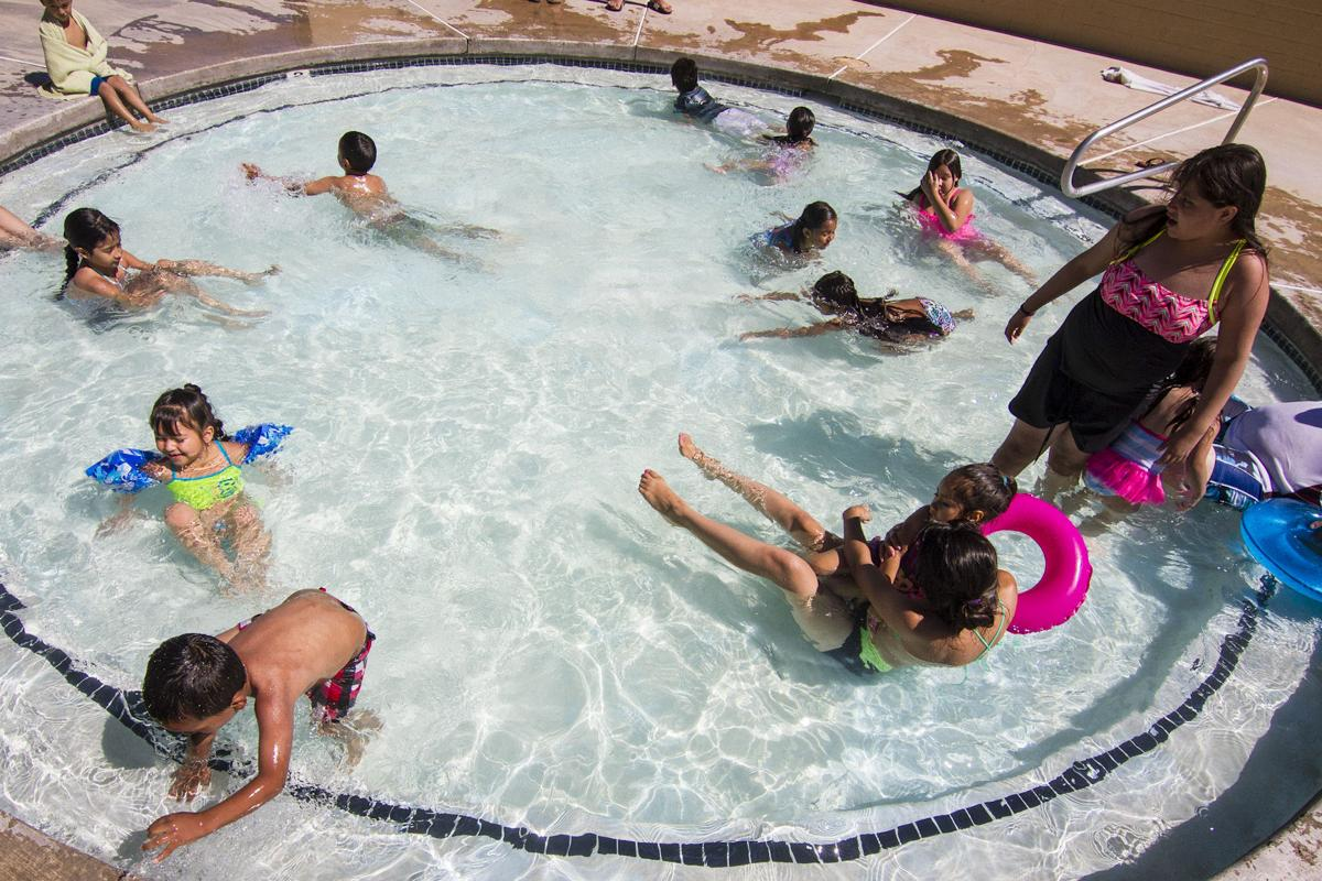 Pool Opening Draws Big Crowds Community