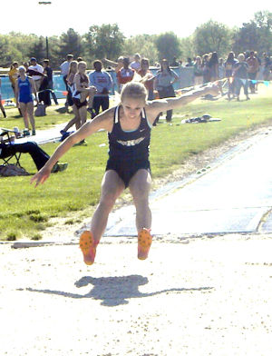 <p>Napoleon's Abby Kuhlman competes in the long jump at the Division II district meet Friday.</p>