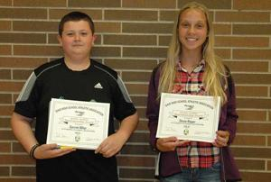 <p>Napoleon Junior High eighth graders Stevie Rieger and Garrett Miller were selected Friday as the recipients of the Ohio High School Athletic Association's Archie Griffin Sportsmanship Award. Rieger participated in volleyball, basketball and track while carrying a perfect 4.0 grade point average throughout the year. Miller participated in football, wrestling and track while maintaining a 3.8 GPA. Both athletes displayed the characteristics for which this award was designed, which is to promote sportsmanship, ethics and integrity. Pictured are Miller (left) and Rieger with their certificates.</p>
