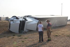 Semi truck flips near NP
