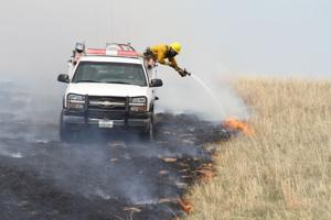 <p>A hot wheel bearing started a fire that burned 237 acres near mile marker 89 on North Highway 83 after landing in a ditch. The fire was carried across the pastures by strong winds.</p>
