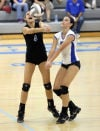 Lake Central's Danielle, left, and Taylor Ellis converge on a play in Thursday's match against Valparaiso.