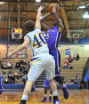 Merrillville's D. J. Williams pulls up for a jumper over Highlands's Matt Benninghoff early in the first quarter Friday.