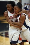 West Side's Ashley Danzy and Tyeisha Hunter are in tears after defeating Lake Central in the semifinals of the Class 4A Lowell Sectional.